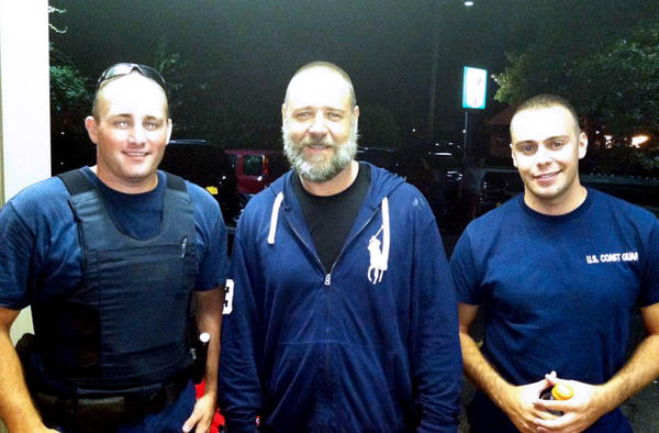 Russell Crowe, center, with Coast Guard petty officers Robert Swieciki, left, and Thomas Watson. The USCG rescued Crowe and a buddy in New York's Long Island Sound over Labor Day weekend.