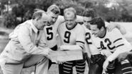 1938: Coach with his players