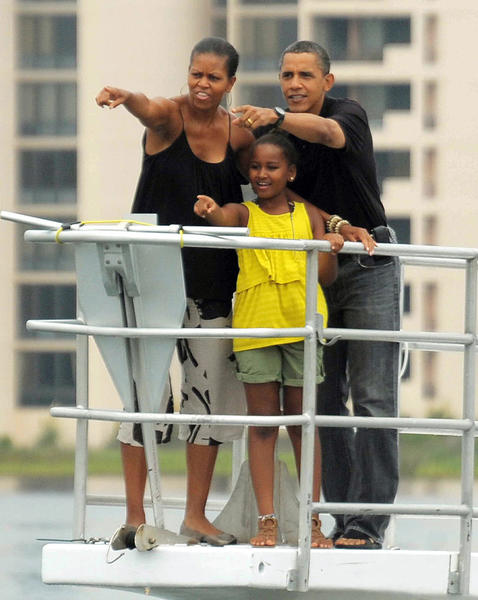 The president, Michelle and Sasha Obama ride a boat in Saint Andrews Bay off Panama City Beach in Florida on Aug. 15, 2010, months after the BP oil spill in the Gulf of Mexico.