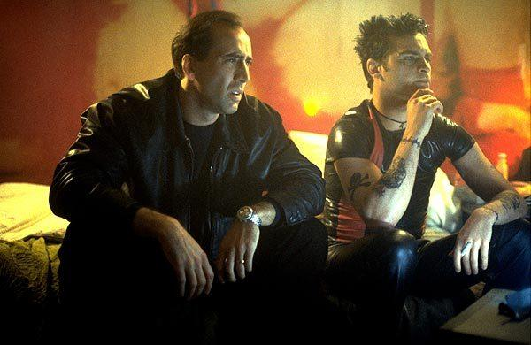 "Nicolas Cage, left, and Joaquin Phoenix in the movie ""Eight Millimeter."""