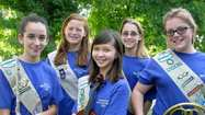 Cadette Girl Scout Troop 9361 formed a musical performance group to earn its Silver Award.