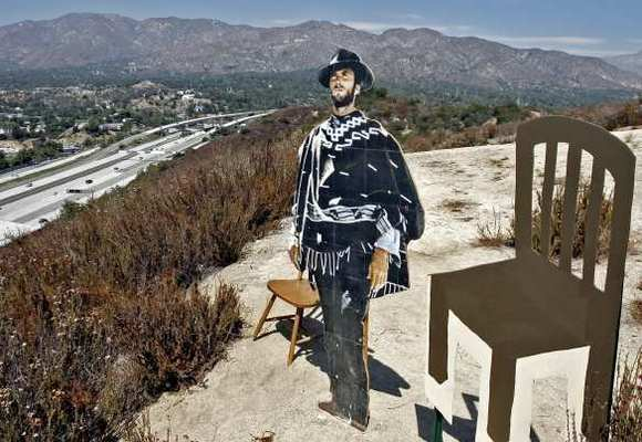 "A cut-out of Clint Eastwood in the hills overlooking Glendale got an ""empty chair"" addition following the famed actor's curious appearance at the Republican National Convention."