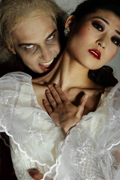 "Luis R. Torres, left, and Maki Onuki in the Washington Ballet production of ""Dracula."""