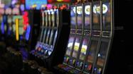 Gambling giant Penn National Gaming Inc. has spent $5.5 million to limit gambling in Maryland — the latest move in a casino-vs.-casino battle that could saturate the airwaves and overwhelm other ballot initiatives this fall.