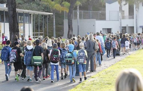 El Morro Elementary School students walk en masse to their first class, back at school after the summer break.
