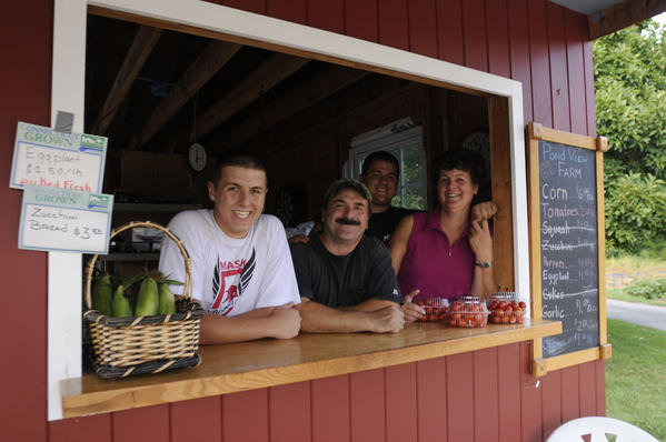 The Panes at Pond View Farm in Monroe; from left, P.J., 17, Philip Pane, son Ryan, 22, and Lisa Pane. The farm has been in her family for generations.