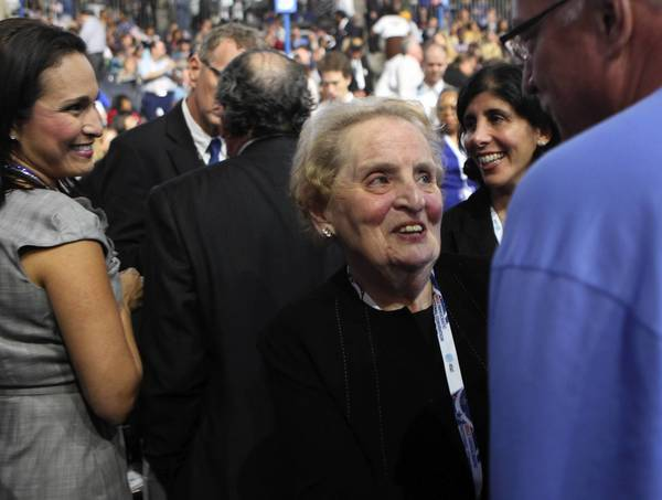 Madeleine Albright works her way through the crowd on the floor.