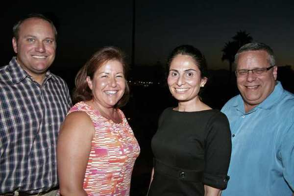 Posing for a photo after the sun went down are new Glendale Healthy Kids Board Members, from left, Patrick Campbell, Lola Abrahamian, Alina Der Sarkissian and Gary Montecuollo.