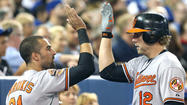 Orioles thrash Blue Jays and move into first-place tie in AL East