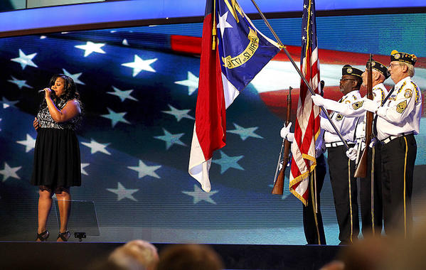 """Glee"" actress Amber Riley, left, sings the national anthem at the start of the Democratic National Convention in Charlotte, N.C. The Disabled American Veterans Honor Guard, right, presents the colors."