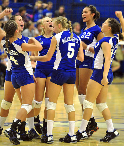 Williamsport celebrates after scoring a point against Clear Spring during Tuesday's volleyball match.
