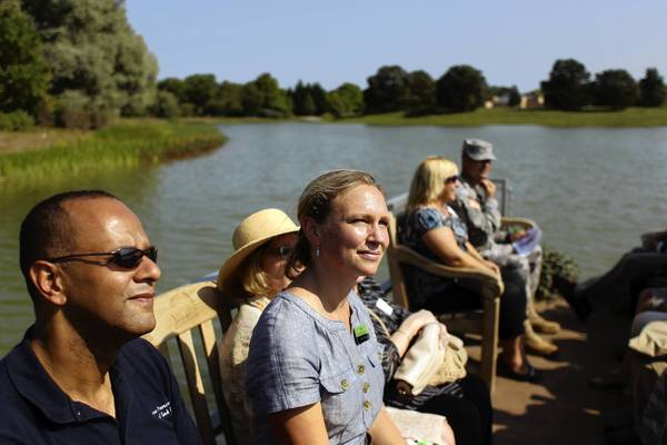 Sophia Siskel, center, president of the Chicago Botanic Garden, joins others Tuesday in a tour of the garden's North Lake after its shoreline restoration project was completed.