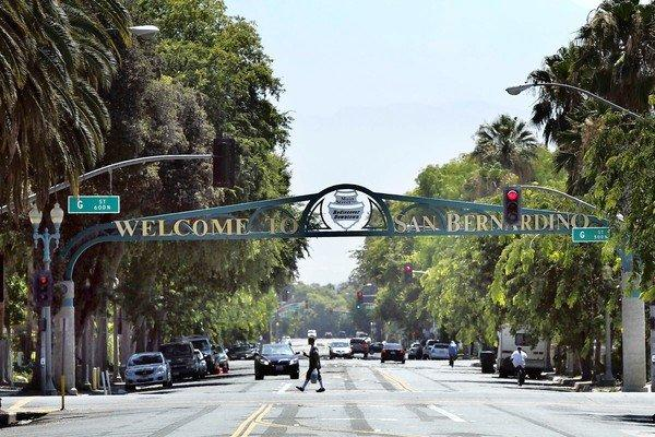 A welcome sign on 6th Street greets visitors to San Bernardino. The city recently filed for Chapter 9 bankruptcy protection, making it the third California city to do so this summer.