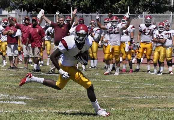 Glendale Community College wide receiver D'Angelo Blake runs unopposed into the end zone for a touchdown.