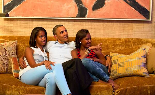 President Obama and daughters Malia, left, and Sasha watch on TV as First Lady Michelle Obama speaks at the Democratic National Convention.