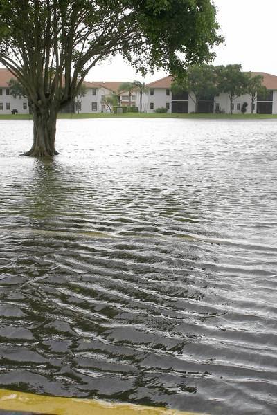 Heavy street flooding in Sun Valley in western Boynton Beach, due to Tropical Storm Isaac causing a lake to overflow onto the street.