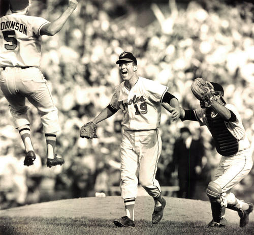 From left, Brooks Robinson, Dave McNally and Andy Etchebarren celebrate after the Orioles shut out the Dodgers, 1-0, to sweep the 1966 World Series.