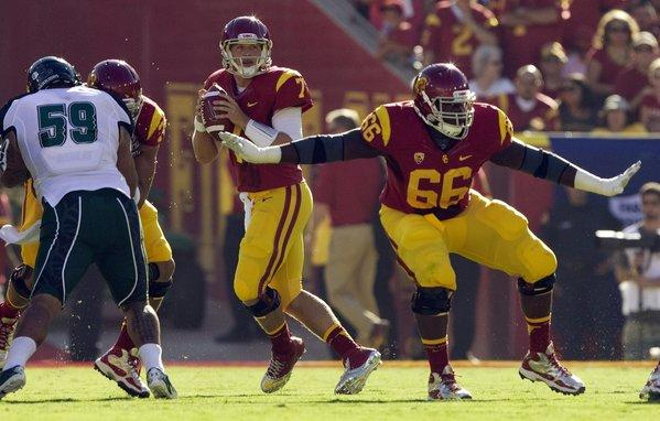 USC guard Marcus Martin (66) gives quarterback Matt Barkley (7) plenty of time to look for an open receiver against Hawaii on Sept. 1.