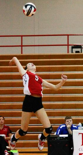 Clark¿s Sydney Wright goes up high for the ball in the Lady Cardinals¿ 3-0 sweep of Bourbon County Tuesday night at Norton Gymnasium.