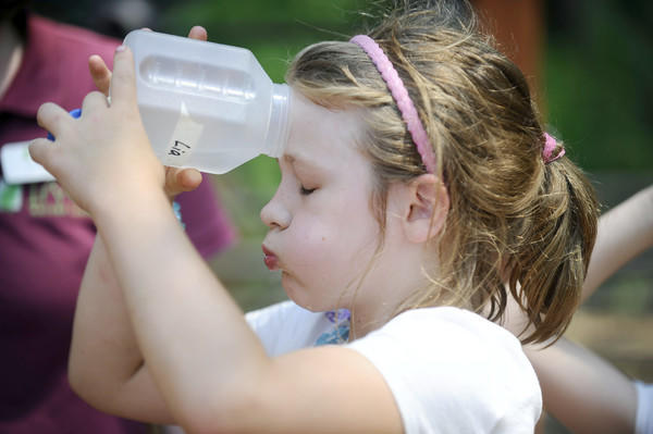 Lia Worth, 7, of Baltimore, a camper of the Nature Nuts Summer Nature Camp at Irvine Nature Center, cools off in near-100-degree heat June 29.