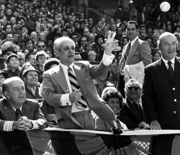 Maryland Gov. Marvin Mandel throws out the first pitch as Baltimore Mayor William Donald Schaefer (left) looks on during Opening Day in 1973. The Orioles finished the season 97-65 before falling to Oakland in five games in the League Championship Series.