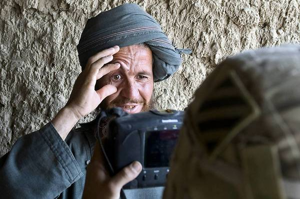 An Afghan villager holds up his eyelids as he is processed for biodata by a soldier from 3rd Platoon, Delta company of the US Army during a patrol at Nevay-deh village in Kandahar province. NATO chief Anders Fogh Rasmussen shared his concerns over the rising number of insider attacks on NATO troops with Afghan President Hamid Karzai. There have been more than 30 such attacks thus far in 2012.