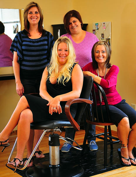 The staff at Vanity Hair & Spa LLC, at 2433 Hedgesville Road in Martinsburg, W.Va., includes, from left, Samantha Carr, owner Melanie Burnell, Crystal Rogers and Tracey Myers.