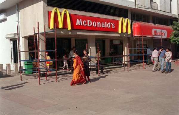 The first golden arches in India were raised in New Delhi in 1996. Now McDonald's plans to open two all-vegetarian restaurants in the country.