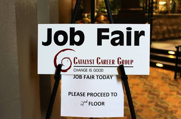 A sign alerts employment seekers where to go for a job fair hosted by Catalyst Career Group at Embassy Suites in Lombard on Wednesday, Aug. 29, 2012.