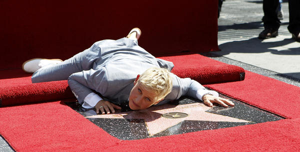 Television personality Ellen DeGeneres lies on her star after it was unveiled on the Walk of Fame in Hollywood, California.