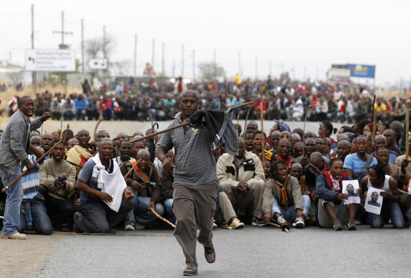 Mineworkers take part in a march at Lonmin's Marikana mine in South Africa's North West Province. More than 3,000 striking South African miners marched through streets near Lonmin's Marikana mine on Wednesday, the largest protest at the hot spot since police shot dead 34 of their colleagues last month.