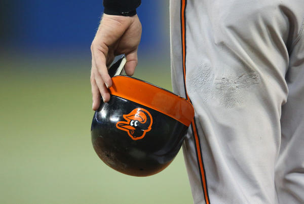 Baltimore Orioles catcher Matt Wieters holds his helmet during their game against the Toronto Blue Jays. The Orioles smashed the Jays 12-0 to tie the Yankees for first place in the AL East.