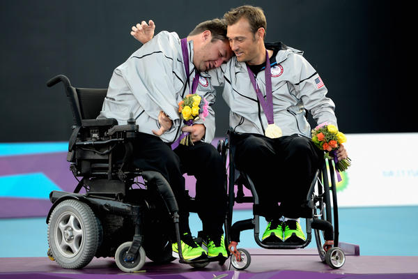 Nicholas Taylor of the United States and teammate David Wagner celebrates after the Quad Doubles Wheelchair Tennis Gold Medal match on day 7 of the London 2012 Paralympic Games at Eton Manor on September 5, 2012 in London.