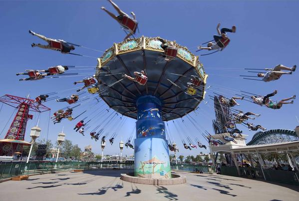 "The Silly Symphony Swings are on Paradise Pier at Disney California Adventure park at <a class=""taxInlineTagLink"" id=""PLGEO000001202119"" title=""Disneyland Park"" href=""/topic/economy-business-finance/tourism-leisure-industry/amusement-theme-parks/disneyland-park-PLGEO000001202119.topic"">Disneyland</a> Resort in Anaheim, California."