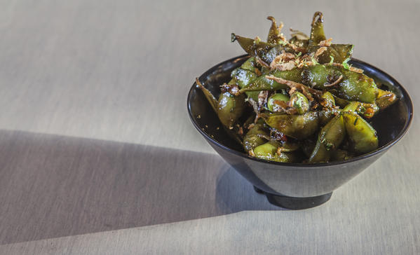 <b>Edamame at Belly Q</b>: Belly Q's edamame with soy-balsamic glaze and crispy fried shallots ($4) is also served at chef Bill Kim's other restaurants, Belly Shack and Urban Belly.