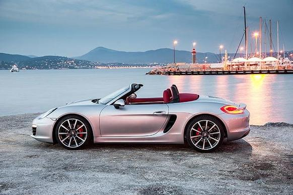 This Boxster is the most visually complete version yet. The wheels have been pushed farther into the car's corners while the air intake in front of the rear wheels is significantly larger. The doors are thus scalloped accordingly, directing air into those enlarged vents.