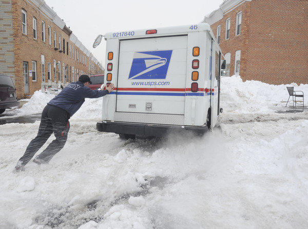 "Mail carrier Jonathan Edwards gets stuck on Foster Avenue in Canton during the ""Snowmageddon"" storm in February 2010."