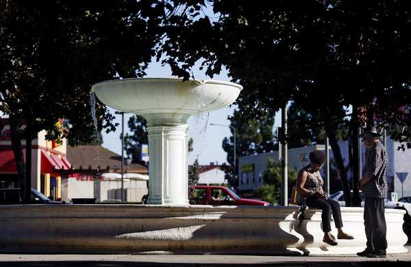 The fountain at Leimert Park Plaza makes a relaxing lounging spot. The park was designed between 1926 and 1928 by the Olmsted Bros. firm, led by sons of the Central Park designer Frederick Law Olmsted.