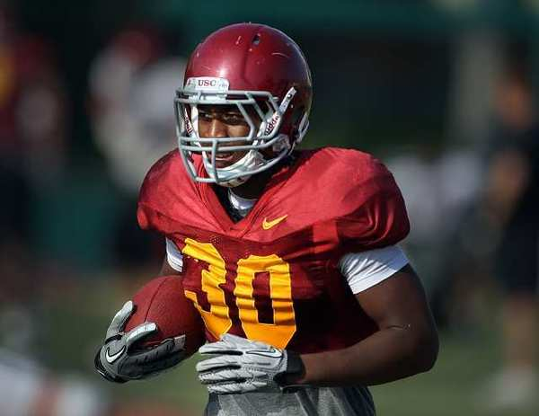 USC tailback D.J. Morgan runs with the ball during practice on Aug. 17.