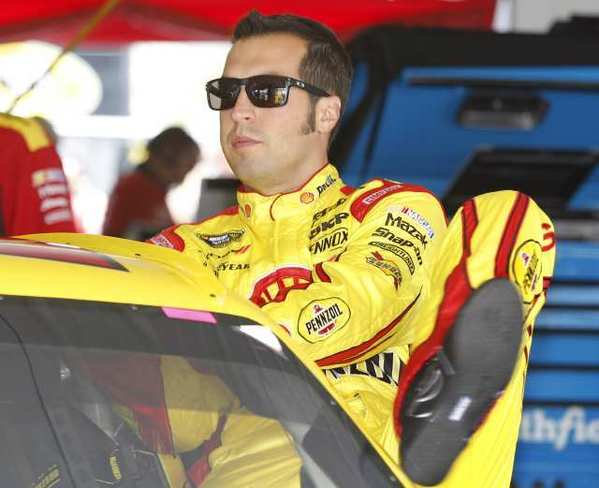 Sam Hornish Jr. climbing into his race car during practice for the NASCAR Sprint Cup Series Pennsylvania 400 on Aug. 3.