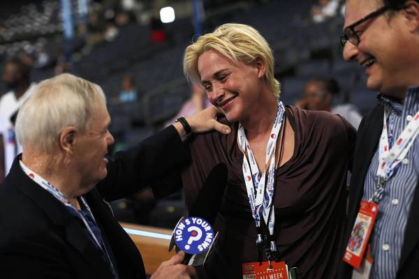 Actors Patricia Arquette and Wayne Knight (R) are interviewed on the floor prior to the start of day two of the Democratic National Convention at Time Warner Cable Arena in Charlotte, North Carolina.