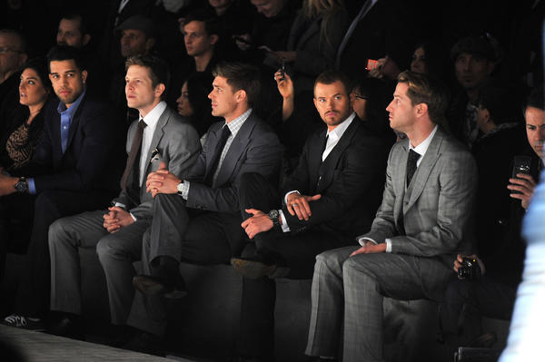 (L-R) Landry Fields of the New York Knicks, actors Matt Czuchry, Chris Lowell and Kellan Lutz attend the Joseph Abboud Fall 2012 fashion show during Mercedes-Benz Fashion Week at Hudson River Park's Pier 57 on February 9, 2012 in New York City.