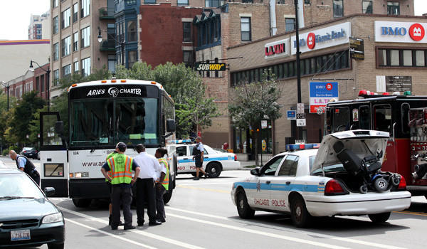 Chicago Police and Fire officials on the scene where a man in a motorized scooter was hit by a bus in the South Loop.
