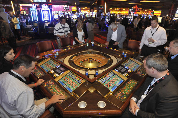 Foreground, left to right: Mike Walsh and Ed Grant play electric roulette at Maryland Live Casino at Arundel Mills mall on opening night.