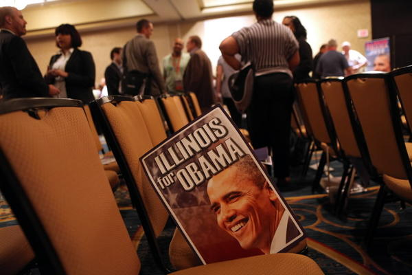 A poster of the president is left behind during the Illinois delegation breakfast Wednesday at the Democratic National Convention.