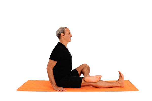 Bend your left knee and place your left ankle above your right knee.