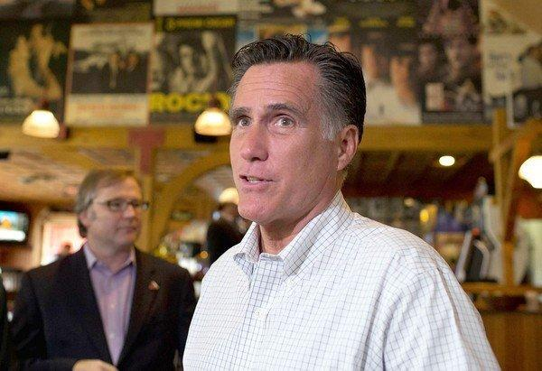 Mitt Romney speaks with reporters at Lui Lui restaurant in West Lebanon, N.H., while taking a break from debate preparation.