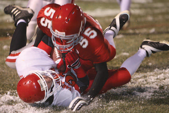 Gettysburg's Erik Hansen (55) tackles an Arlington player in November 2008. Hansen died Tuesday in a sewer gas incident. American News File Photo by John Papendick