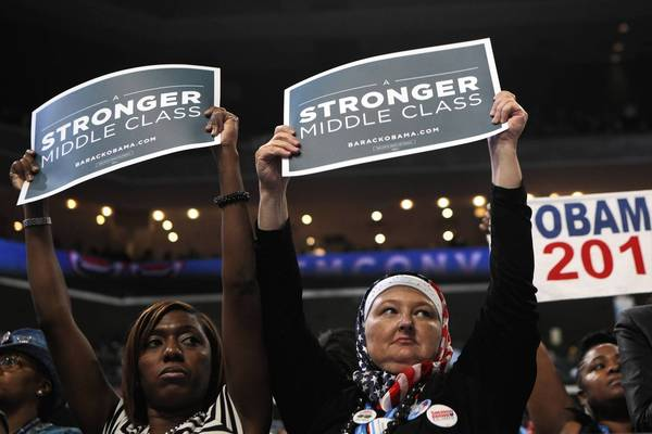 Ohio delegates show support for former President Bill Clinton as he speaks in support of President Barack Obama at the Democratic National Convention.