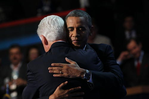 President Barack Obama joins Former President Bill Clinton after Clinton spoke at the Democratic National Convention at Time Warner Cable Arena in downtown Charlotte, N.C.